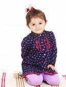 stock photo of montessori school  - Little girl sitting on the rug in Montessori kindergarten - JPG