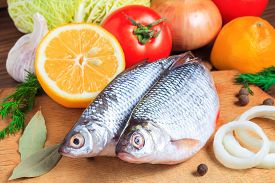 pic of freshwater fish  - Fresh fish with vegetables and spices - JPG
