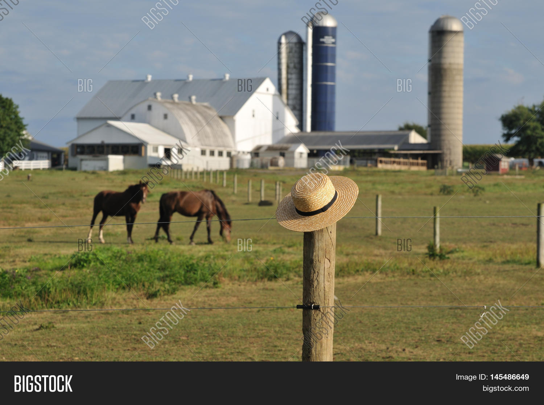 Amish Fence Posts : Amish straw hat laying over fence image photo bigstock