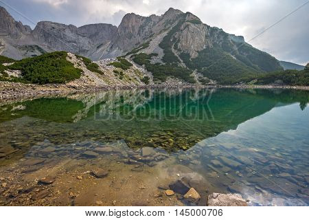 Dark Clouds over Sinanitsa Peak and reflectionin the lake, Pirin Mountain, Bulgaria