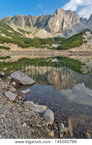 White rocks of Sinanitsa peak and  reflectionin the lake, Pirin Mountain, Bulgaria