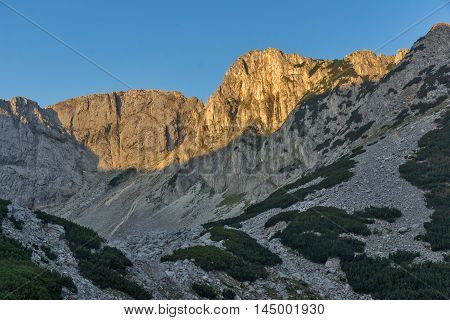 Sunrise with red rocks of Sinanitsa peak and  the lake, Pirin Mountain, Bulgaria