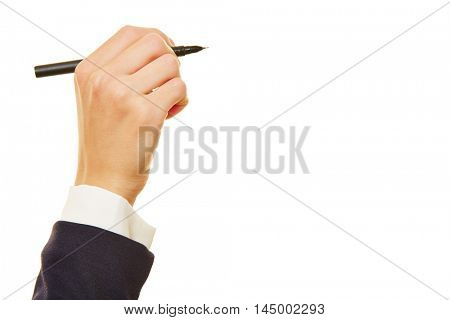 Business man holding black pen sideways