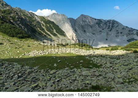 Clouds over Sinanitsa peak covered with shadow, Pirin Mountain, Bulgaria