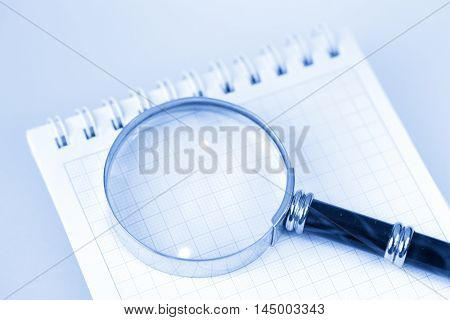 magnifying glass & notepad