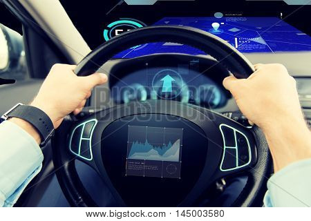 transport, business trip, technology and people concept - close up of male hands holding car wheel and driving with graph on board computer screen