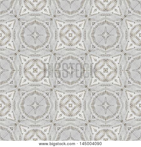 White organic cotton crochet lace background backdrop for scrapbook top view. Collage with mirror reflection. Seamless kaleidoscope montage for cushion pillow tablecloth cloth bed cloth