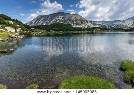 Amazing panorama of todorka peak and Reflection in Muratovo lake, Pirin Mountain, Bulgaria