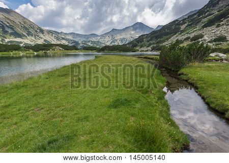 Panoramic view of Banderishki chukar peak and green meadows around Muratovo lake, Pirin Mountain, Bulgaria