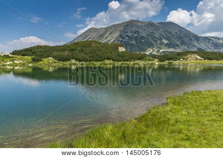 Amazing landscape of todorka peak and Reflection in Muratovo lake, Pirin Mountain, Bulgaria