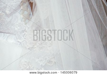 The white wedding dress with veil and jewelry.