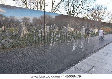 WASHINGTON, DC - DEC 19: Wall of Korean War Veterans Memorial in Washington, DC. Taken on December 19, 2015 in Washington DC, USA.