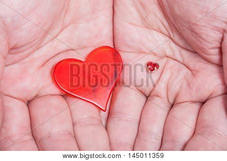 Two Red Hearts In Male Handful