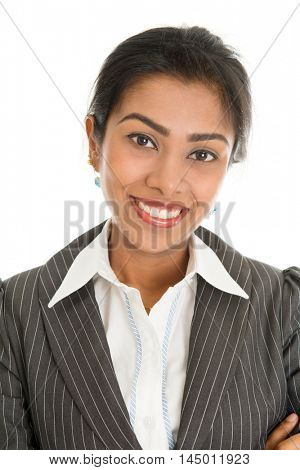 Close up headshot of black business woman in formalwear smiling and looking at camera, isolated on white background.