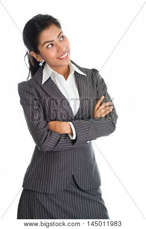 Portrait of black business woman in formalwear arms crossed and smiling, looking away, isolated on white background.