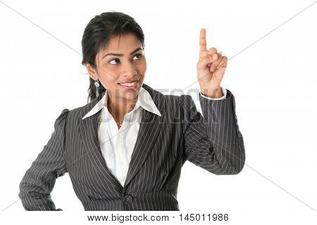 Black business woman in formalwear finger pointing at blank space, isolated on white background.