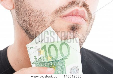Young Male Scratching Beard With Money