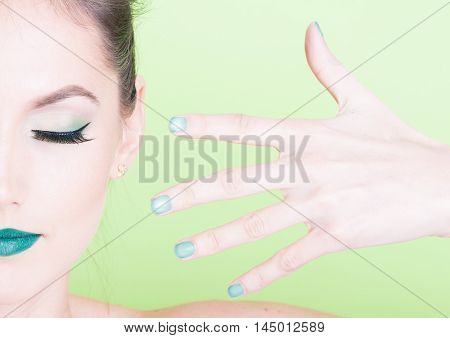 Close-up Of Professional Green Make-up With Matching Nails