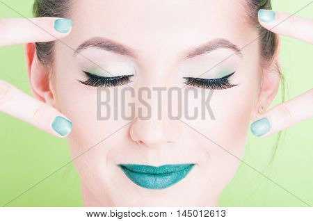 Girl Posing With Professional Trendy Make-up And Victory Gesture