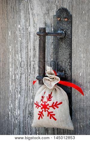 A gift hangs on the handle of door