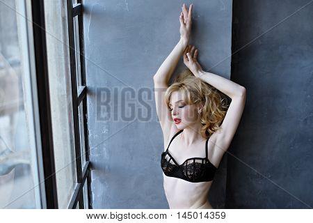 Female Portrait Of Cute Lady In Black Bra Indoors. Close Up Beautiful Sexy Model Girl In Elegant Pos