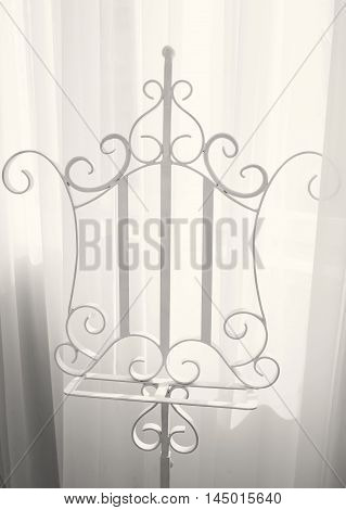 white metal hanger for clothes in the room.