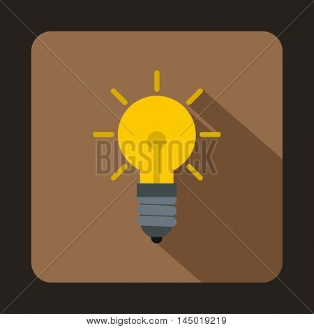 Light bulb icon in flat style on a coffee background