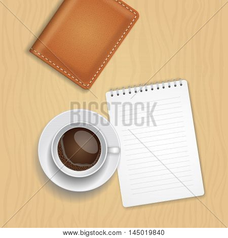 coffee cup and blank notepad on wood background. Office desk composition