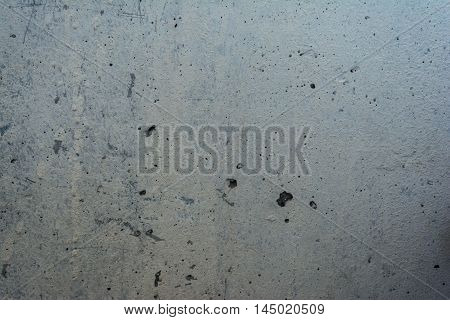 Concrete wall is destroyed. Background texture. Gray.