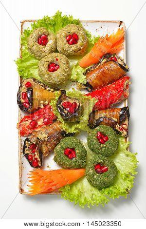traditional Georgian cuisine - vegetable rolls and pates nut paste (pkhali)