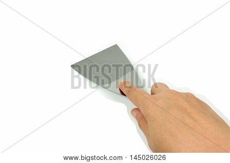 steel putty spattles in hand on white background.