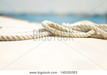 White rope on the Black sea background.