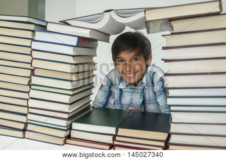 Kid with a lot of books