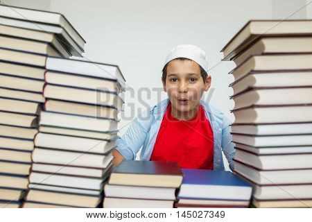Muslim Arabic kids with a lot of books in library