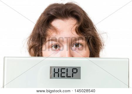 Obesity Concept. Overweight Woman Holds Scales With Help Written