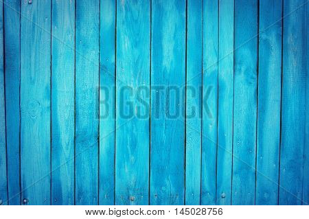 blue shabby wooden planks, palisade background with scratches