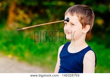 Boy Playing Playing With Bow And Toy Arrow