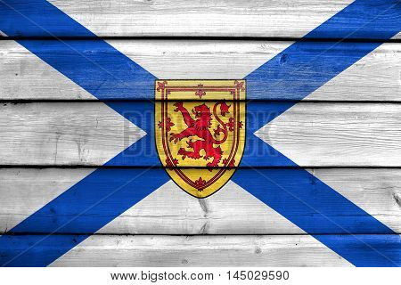 Flag Of Nova Scotia Province, Canada, Painted On Old Wood Plank Background