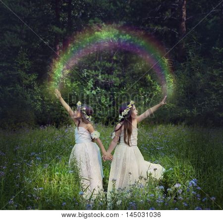 Photo manipulation with young girls who make a rainbow