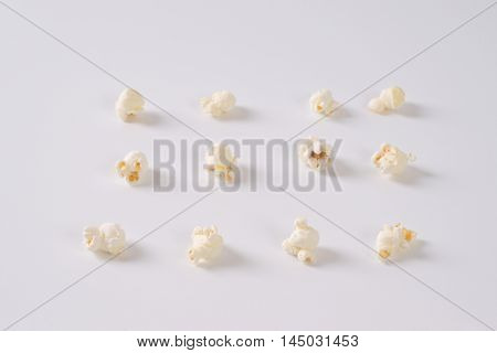 pieces of fresh popcorn arranged on white background