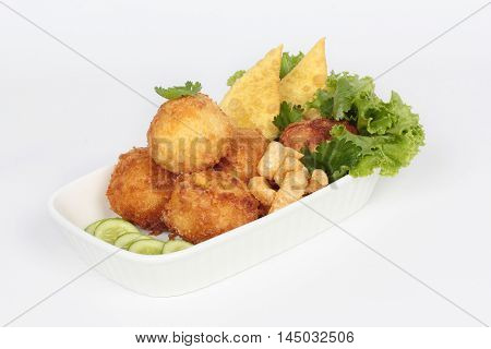 Deep fried minced pork in potato on white background.