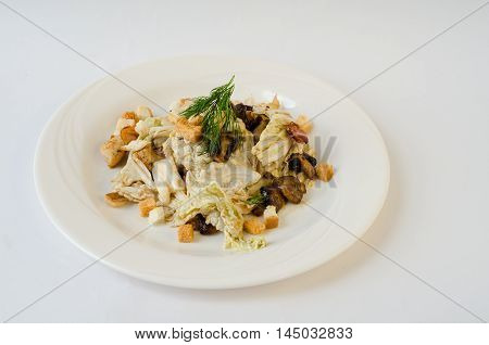 Salad with chicken, mushrooms, bread croutons and cabbage