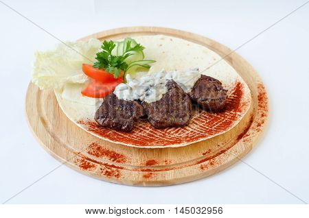 Minced meat with sauce on plate. Selective focus