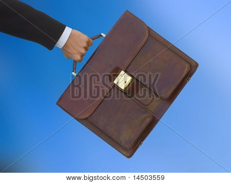 A businessman run to the job meeting at the office with the diplomatic bag