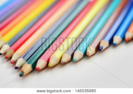 Colored pencils closeup on a white background