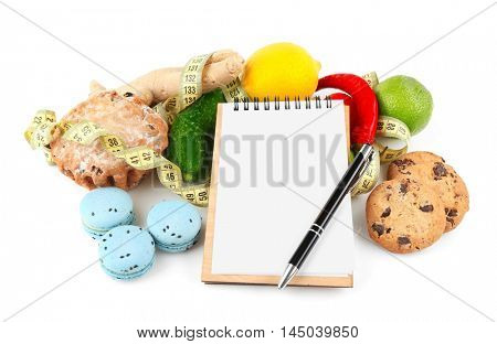 Vegetables, products and notepad on white background