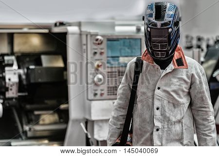 Industrial worker in protective workwear, toned image,