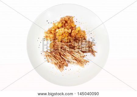 Deep fried sweet corn and sliced taro with sesame on white background.