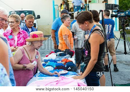 Lancaster PA - August 30 2016: Hillary Clinton 2016 hats buttons stickers and tee shirts for sale following a rally for Virginia Senator Tim Kaine.