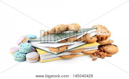Bakery products and notepad on white background